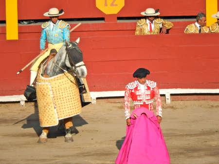 capote: PERU - NOV 2013: Picador and novillero. Bullfighting. Padilla bull. brave Editorial