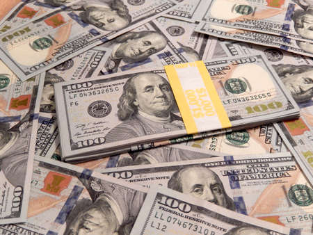 us currency: New one hundred dollars pile as background