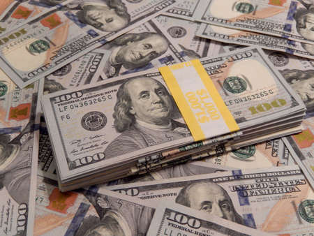 Stack of new one hundred dollar bills close-up