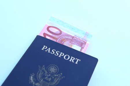 US Passport with Euro Notes isolated over a white background