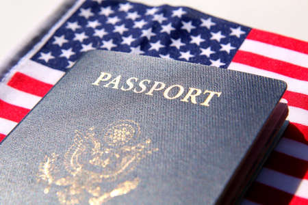 US passport over a red, white and blue flag background Archivio Fotografico