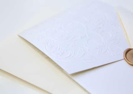 wedding reception decoration: Decorative wedding invite isolated over a white background Stock Photo