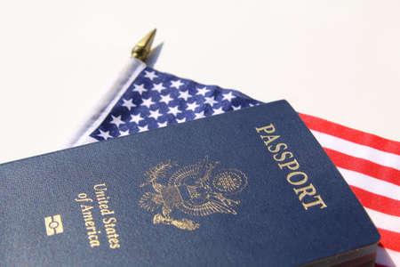 A horizontal image of an American passport on an American flag Standard-Bild
