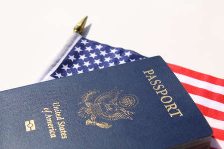 A horizontal image of an American passport on an American flag Archivio Fotografico