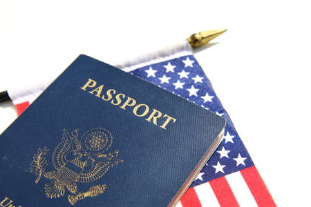 A horizontal image of an American passport on an American flag Фото со стока - 36889236