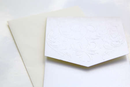 wedding invite and card over a white background photo