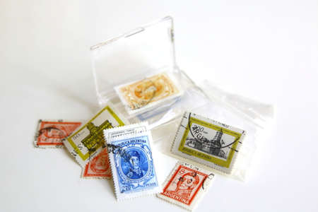 postage stamps: Collection of old postage stamps isolated over a white background
