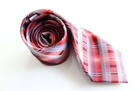 menswear: Red and White Striped Tie Isolated on White Background.