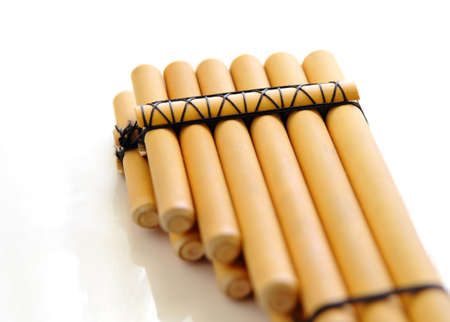 pan flute: pan flute close-up isolated over a white background Stock Photo