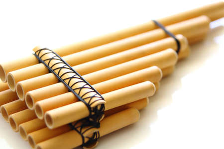 panpipe: pan flute close-up over a white background