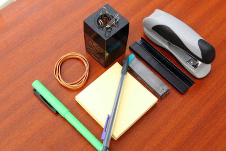 obsessive compulsive: office desk and tools over a brown table background Stock Photo