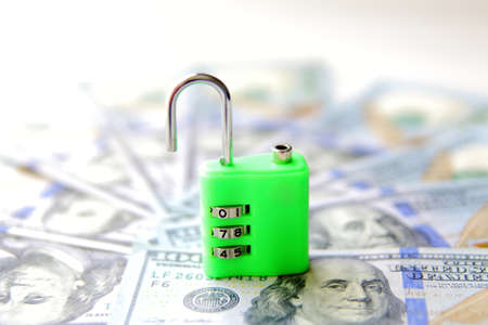 insecure: insecure money padlock concept. US dollars currency banknotes Stock Photo