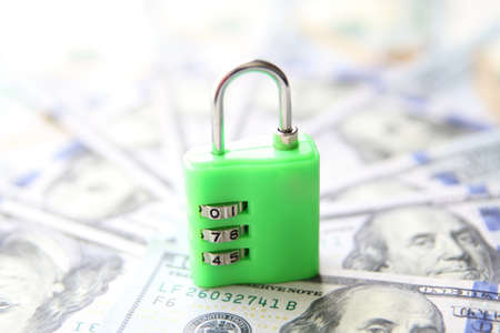 secure money: Secure money padlock concept. US dollars currency banknotes