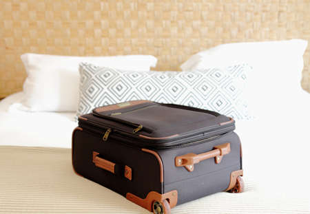suitcase close-up on the bed inside a hotel luxury room