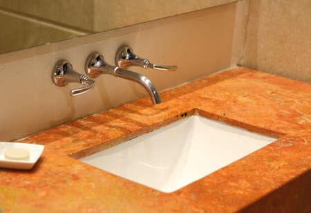A luxury bathroom sink with chrome fixture Stock Photo