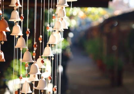 chime: wind chime. bells hanging ornament over a blur background