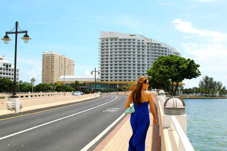 features: Beautiful casual woman walking in downtown Miami Financial District Brickell cityscape