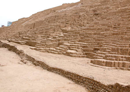 miraflores district: LIMA, PERU - NOV 24, 2015: The Huaca Pucllana is a  clay pyramid located in the Miraflores district of Lima, Peru Stock Photo