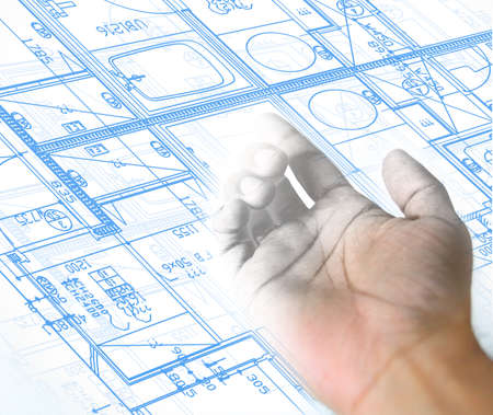 forefinger: hand drawing over a blueprint architectural background