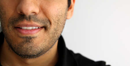 one man: Detailed image of young man smiling with white teeth