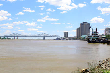 New Orleans paddle steamer in Mississippi river. Bridge