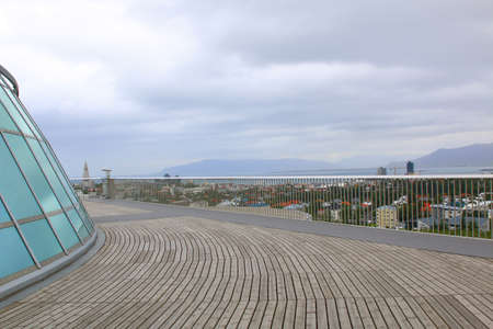 grindavik: Wide-angle aerial view of Reykjavik, Iceland with harbor and skyline mountains. Stock Photo
