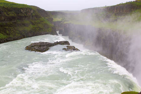Field of lava and Gullfoss waterfall in Iceland Golden Circle. Stock Photo