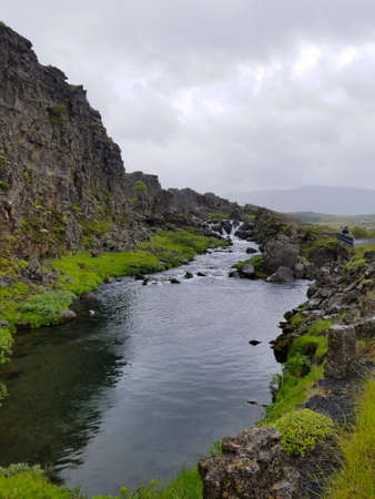 Large waterfall with rocks in Iceland, Europe. Outdoors