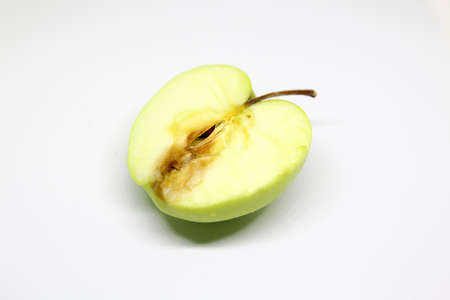 rotten green apple isolated over a white background