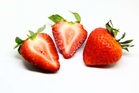Strawberries fruit close up isolated over a white background
