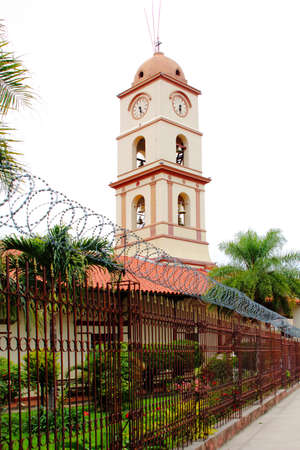 beautiful church in Santa Cruz de la Sierra city center, Bolivia. with blooming flowers