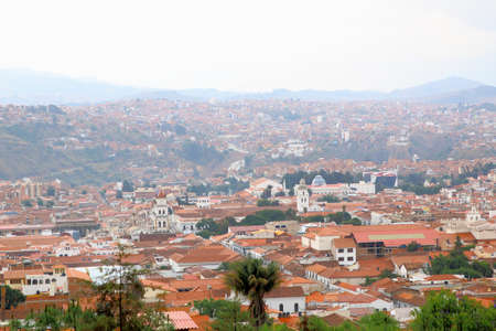 Aerial view of of Sucre, Bolivia with mountains visible in the background. City view.