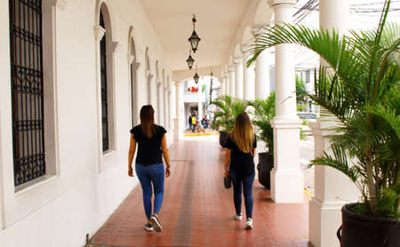 two female tourists walking in Santa Cruz de la Sierra, Bolivia city center at day time
