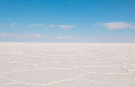 Uyuni Salar in Bolivia.  Blue Sky and white salt ground. Uyuni, Bolivia