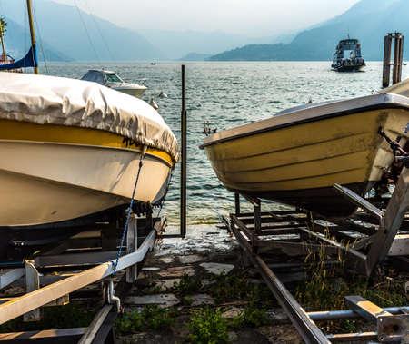 Boats on Como lake coast, Italy