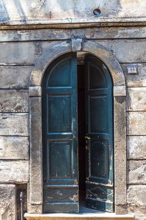 An old door, element of Italian architecture Stock Photo