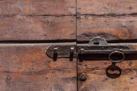 door handle: old bolt on a wooden door