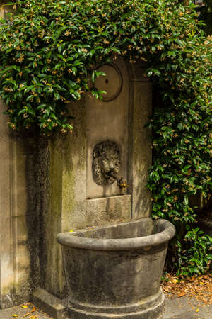 Old style drinking fountain at the Como, Italy Stock Photo