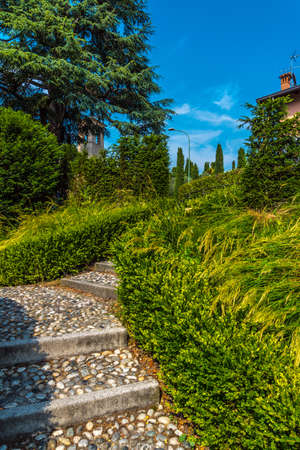 An old cobbled stairs in Bellagio park. Province Como. Italy Stock Photo