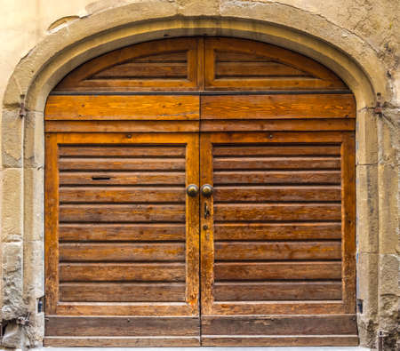 An old wooden doors, element of Italian architecture Stock Photo
