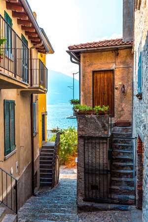 View of Bellagio old cobbled street and lake Como. Italy