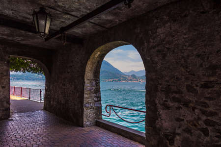 View form medieval arch on lake Como, Italy