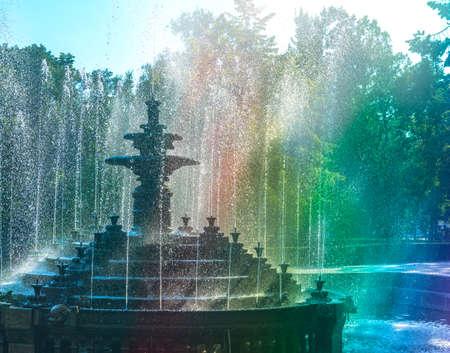 Fountain with colorful rainbow. Stefan cel Mare Central Park. Chisinau, Moldova