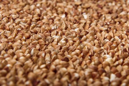 uncooked: Uncooked buckwheat closeup macro Stock Photo