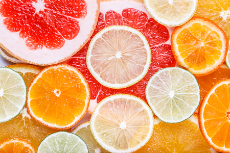 Fresh sliced citrus on white background close-up macro isolated Фото со стока