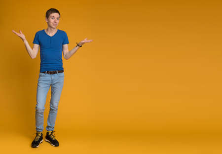 full length: Full length picture of a young casual man welcoming you Stock Photo