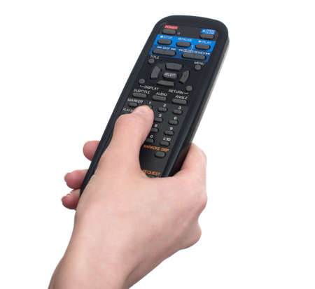 Hand pressing remote control isolated on white Stock Photo