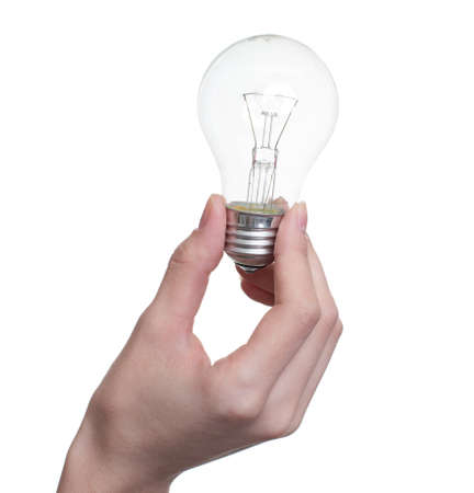 socle: Giant tungsten lamp in hand  isolated on the white background Stock Photo