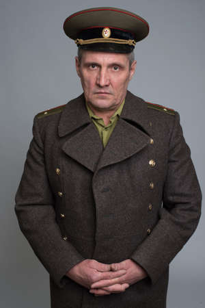 colonel: portrait of Russian military officer in greatcoat