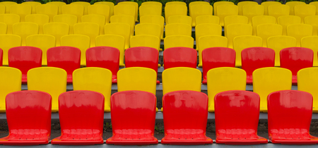 yellow-red grandstand at the stadium Stock Photo